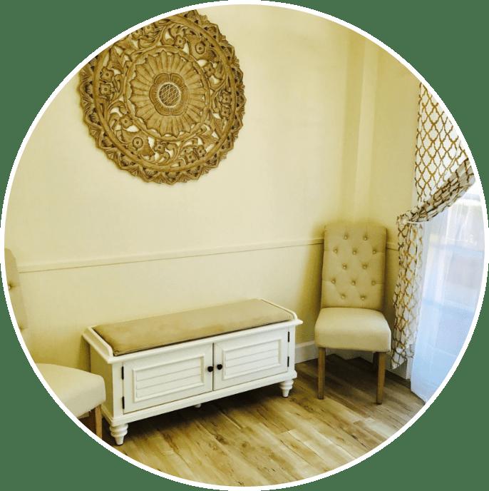 beige chair in corner of room